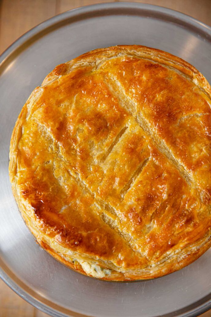 Spinach and Chicken Pie top-down on cake stand