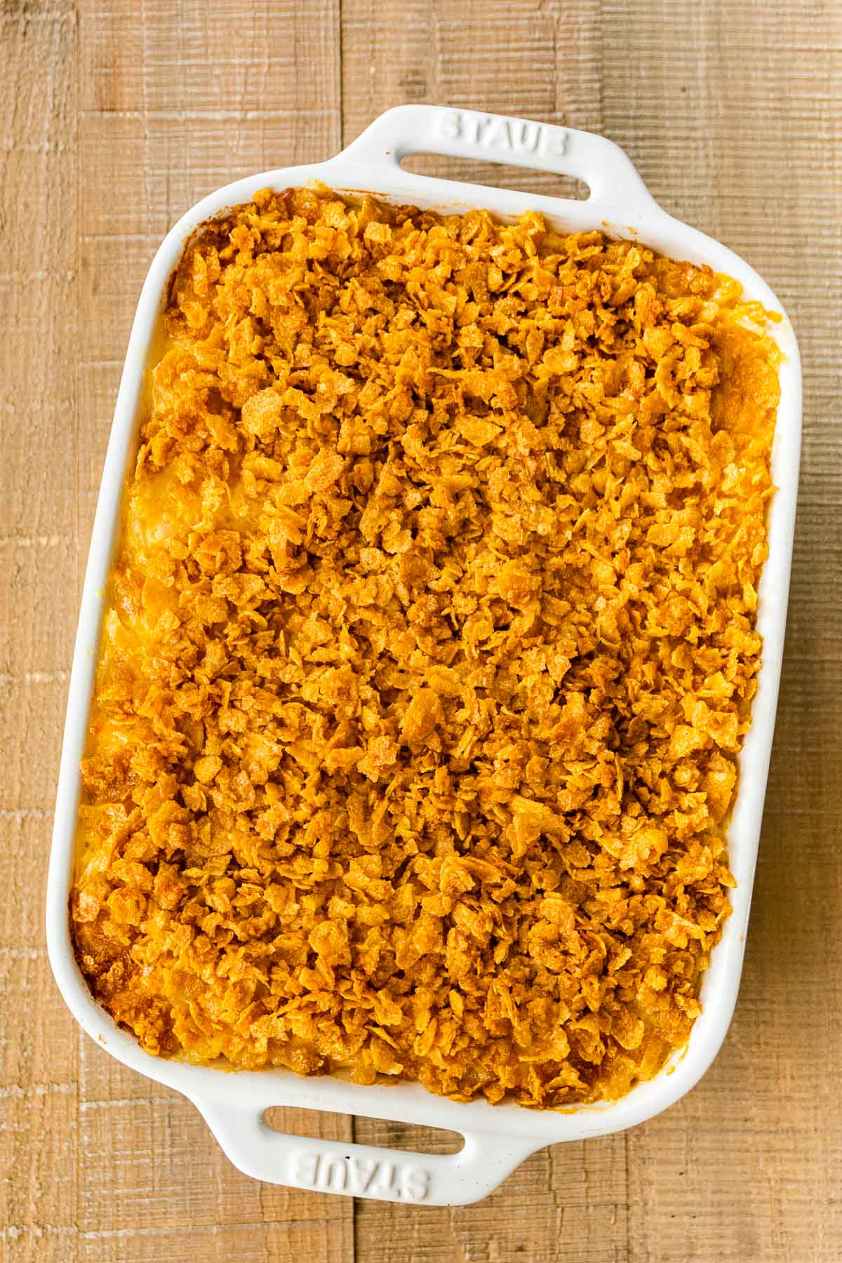 Funeral Potatoes assembled in baking dish with topping after baking