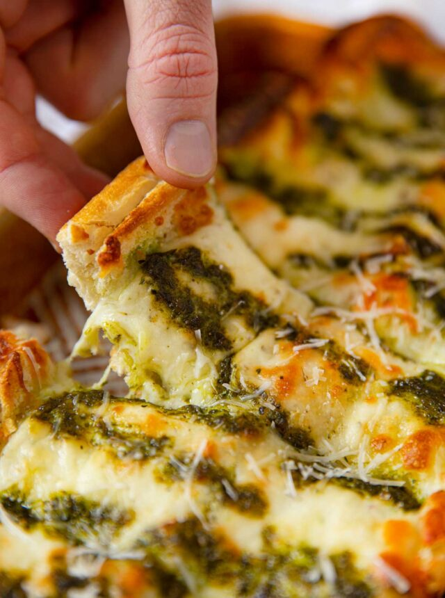 Pesto Cheesy Bread lifted slice