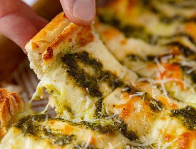 Pesto Cheesy Bread lifted slice