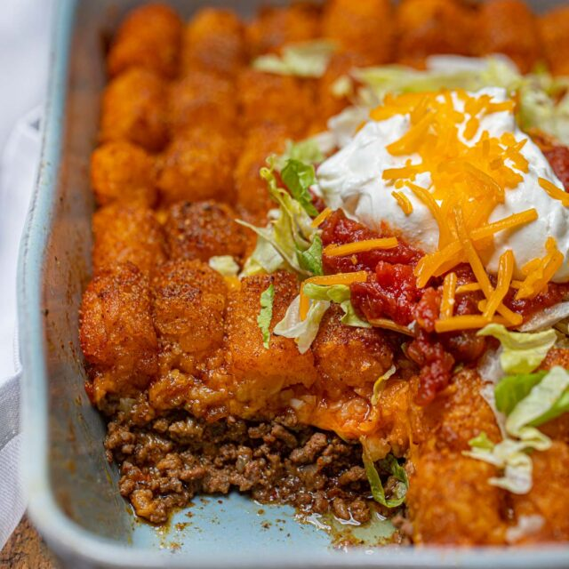 Cheesy Taco Tater Tor Casserole cross section in baking dish