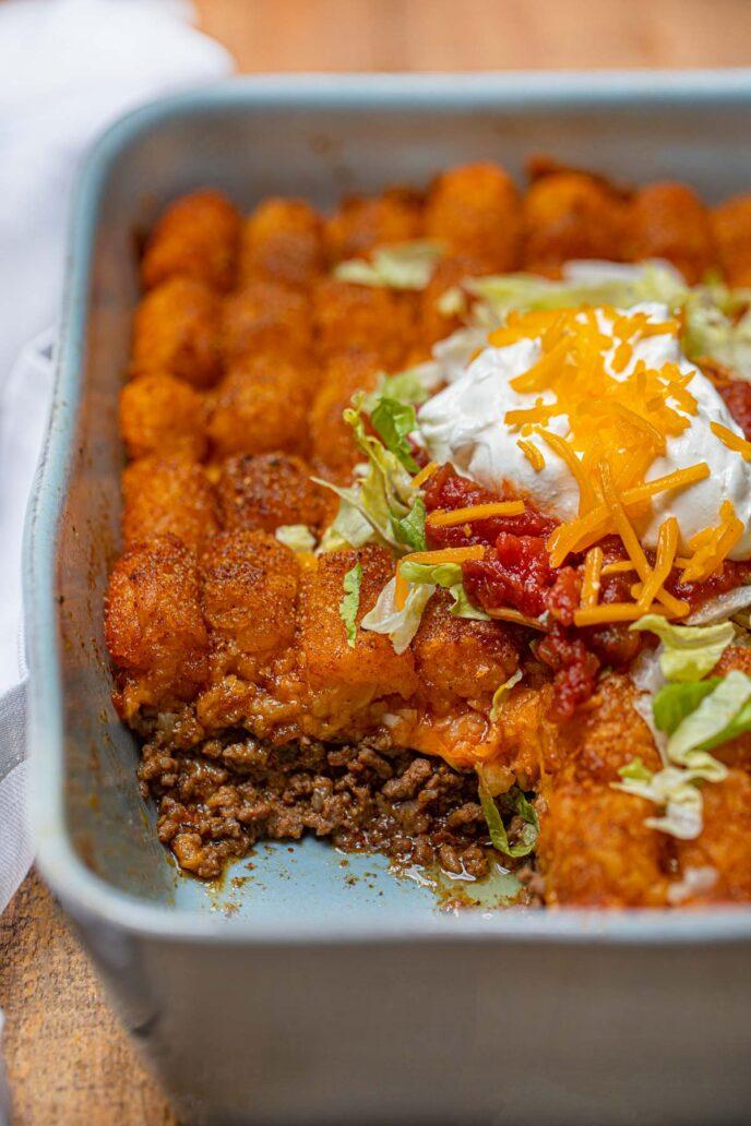 Cheesy Taco Tater Tor Casserole cross section in baking dish