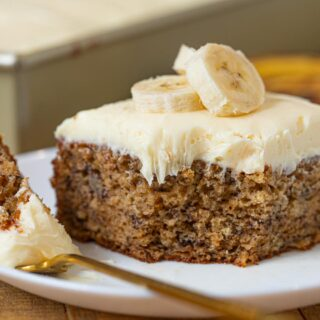 Banana Cake with frosting on white plate