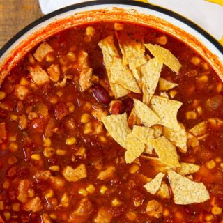 Chicken Taco Soup in bowl with tortilla chip garnish