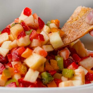 Fruit Salsa in bowl with cinnamon chip dipping