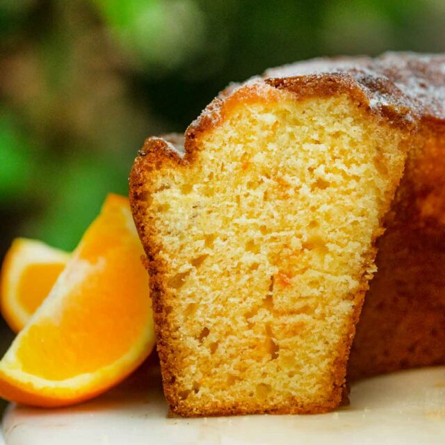Orange Bundt Cake on cake stand, sliced