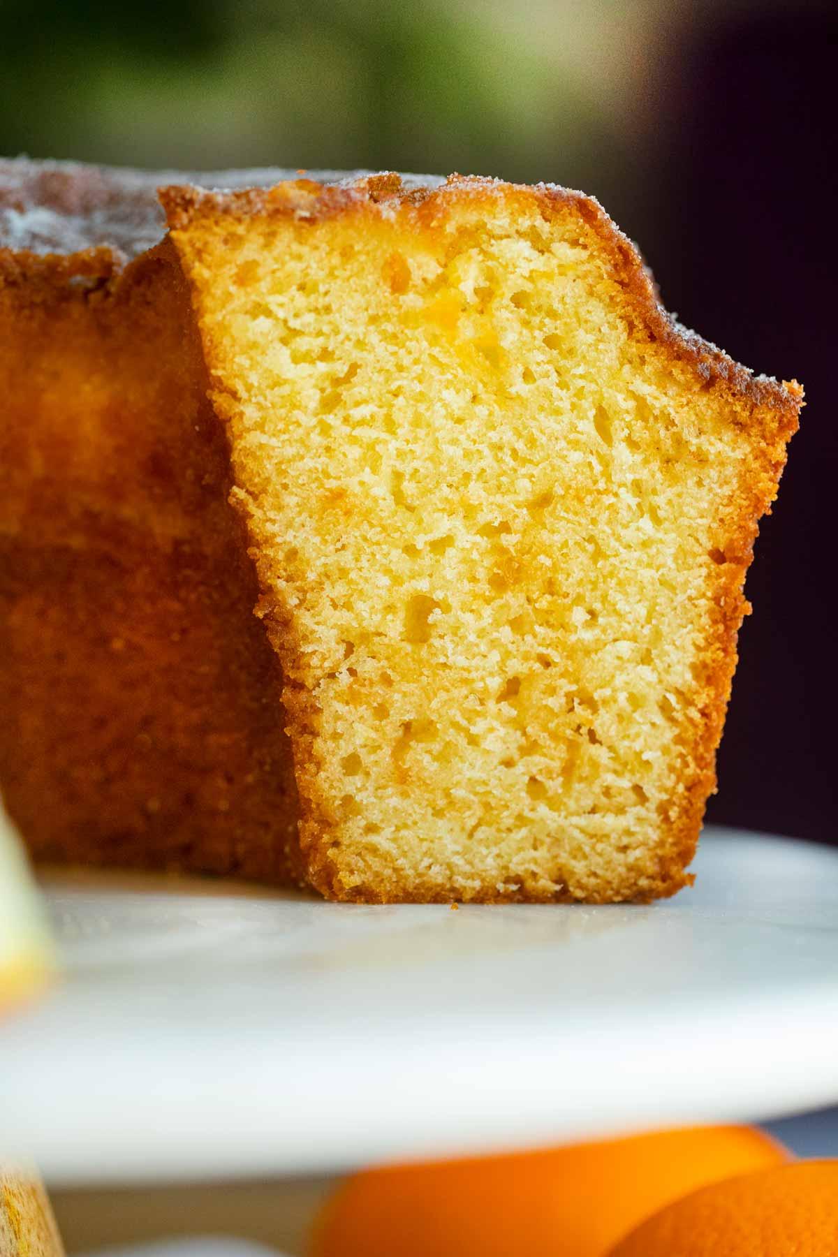 Orange Bundt Cake on cake stand, sliced