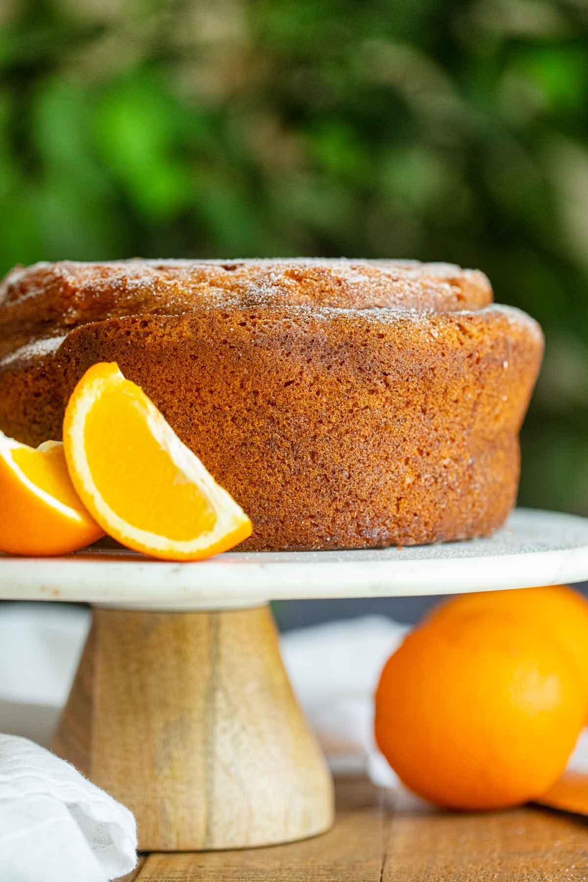 Orange Bundt Cake on cake stand, unsliced