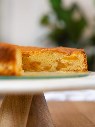 Peach Cake sliced open on cake stand