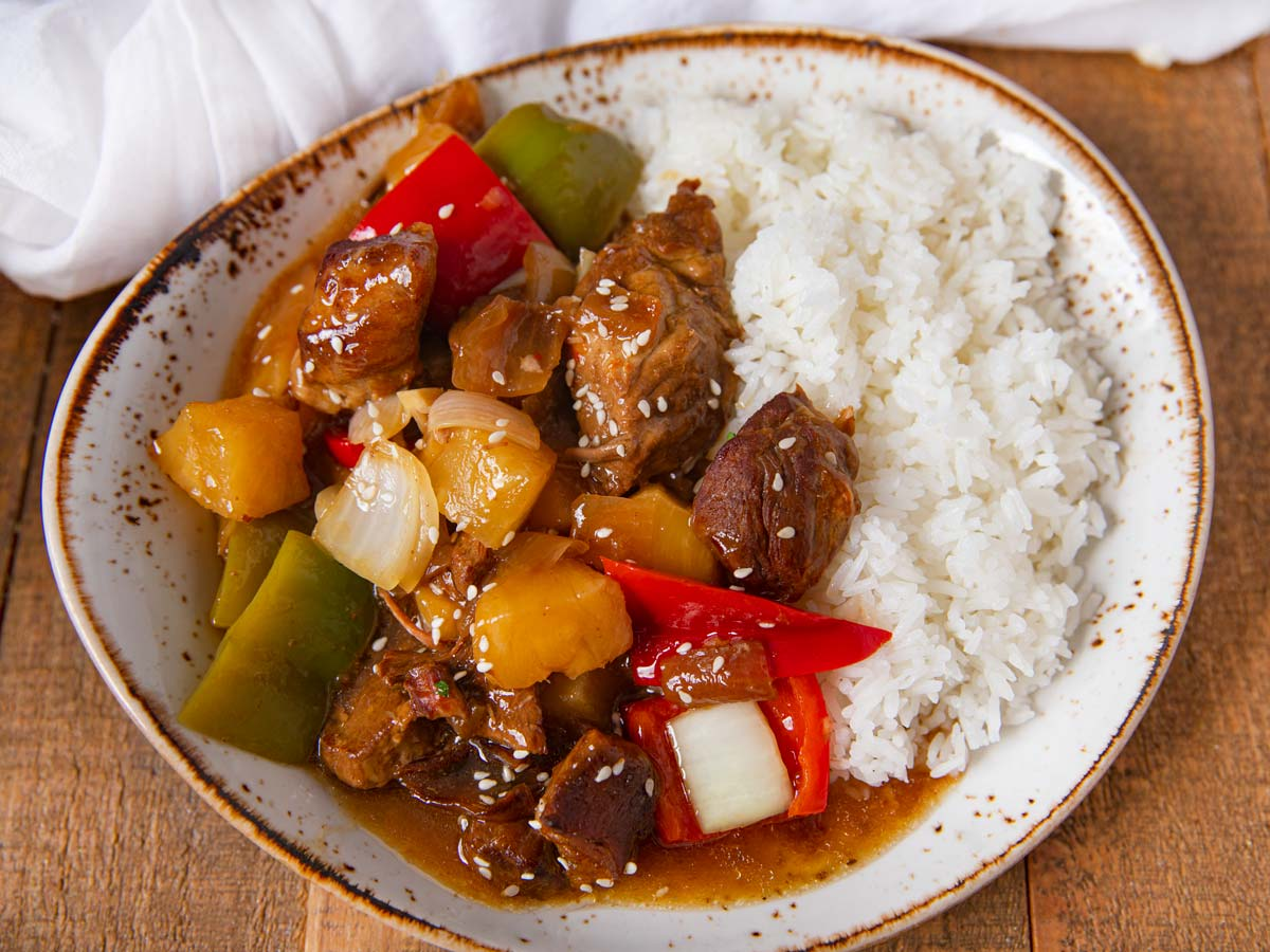 Slow Cooker Sweet and Sour Pork on plate with rice