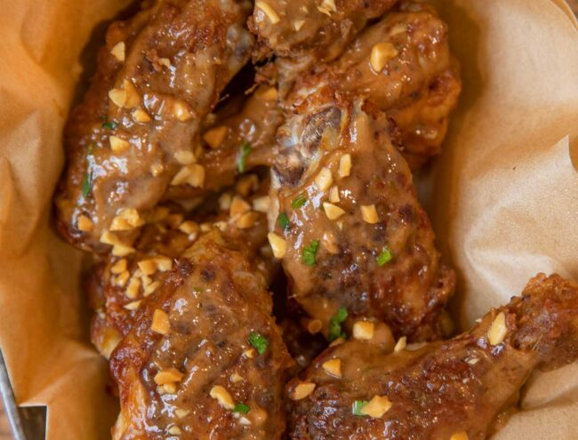 Thai Peanut Chicken Wings with crushed peanuts