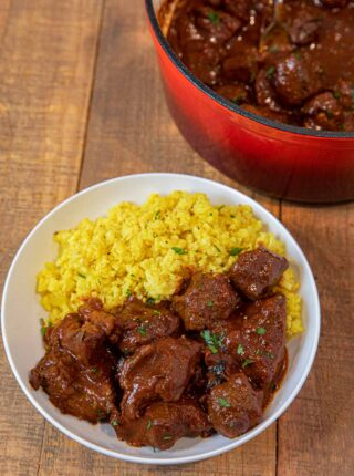 Chile Beef Colorado in bowl with yellow rice