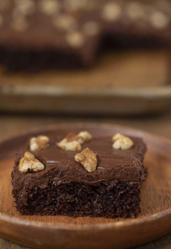 Texas Walnut Chocolate Sheet Cake slice on wooden plate