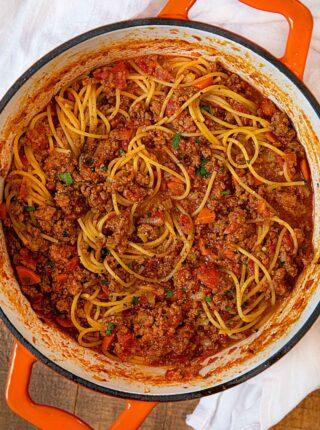 Homemade Bolognese Pasta in Orange Dutch Oven