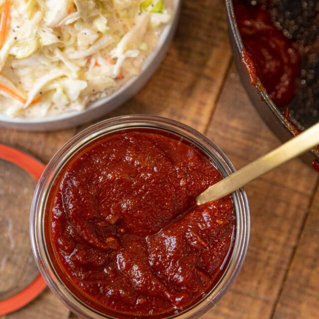 Memphis BBQ Sauce in glass jar with spoon