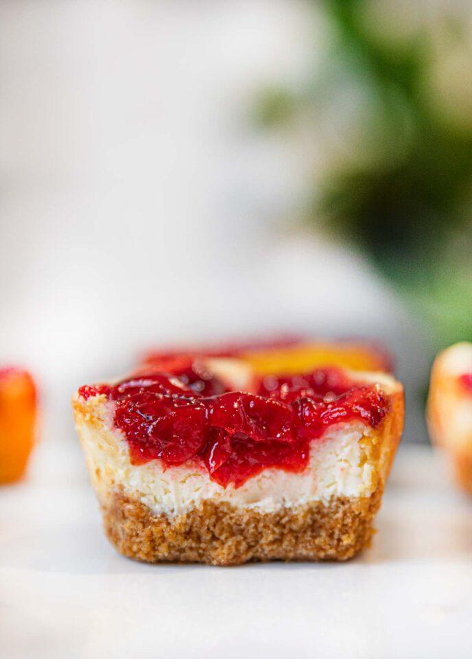 Bite taken out of Mini Cherry Cheesecake
