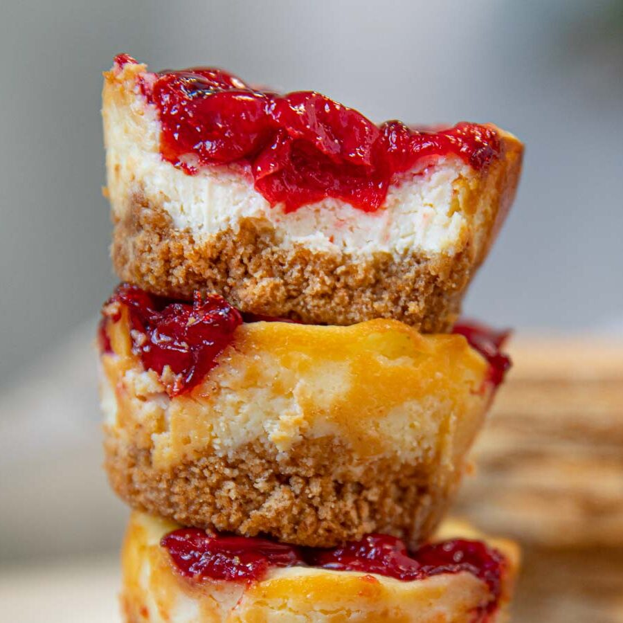 Mini Cherry Cheesecake Muffin Bites in a stack