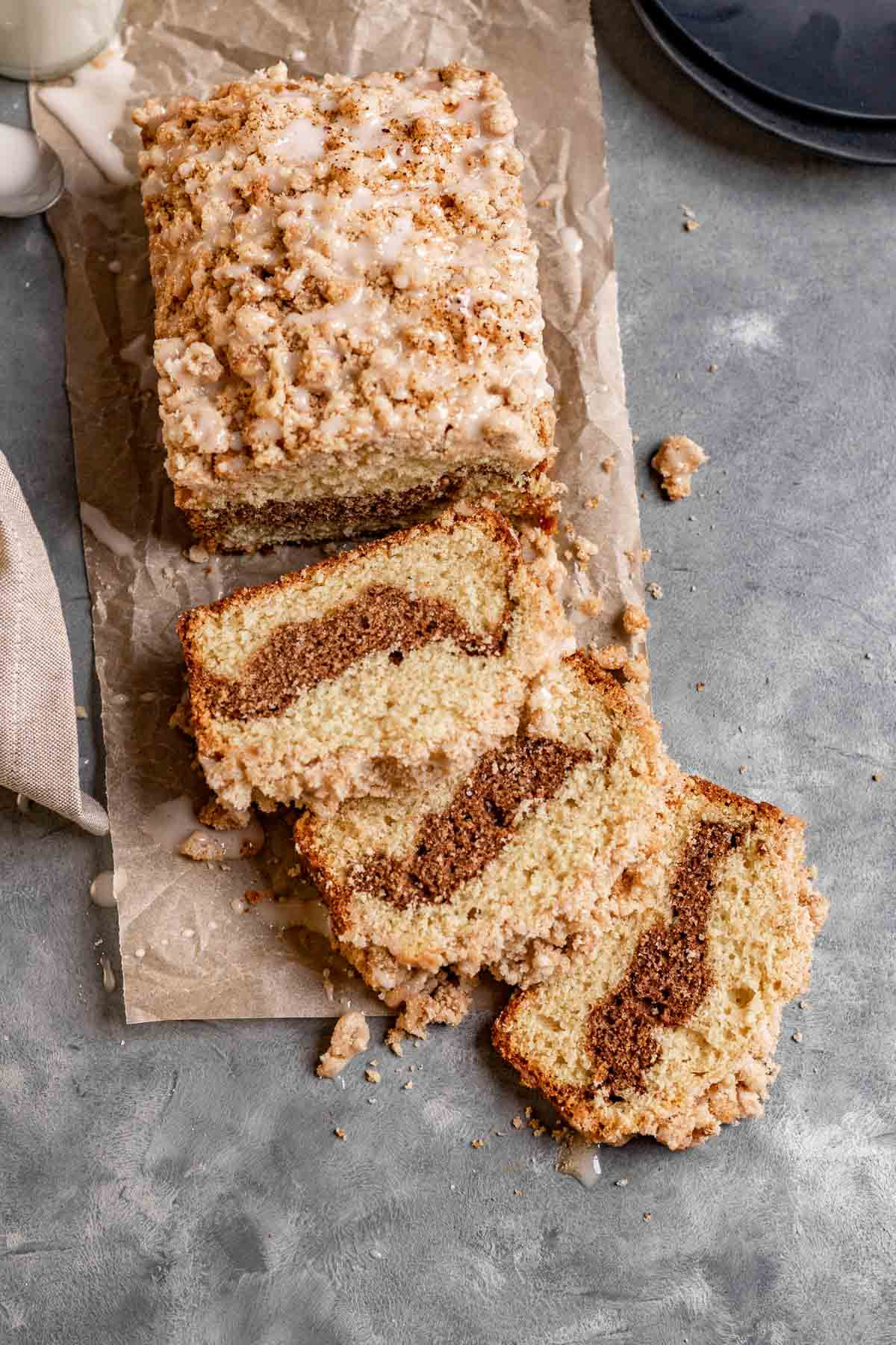 New York Crumb Loaf Cake sliced on parchment