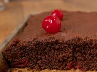 Chocolate Texas Sheet Cake with Cherries and chocolate frosting