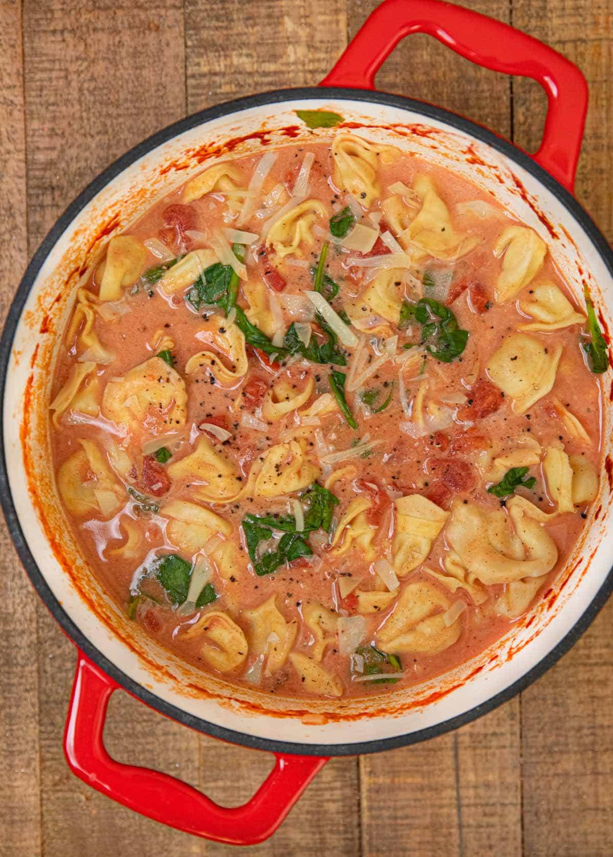 Creamy Tomato Tortellini Soup in red dutch oven