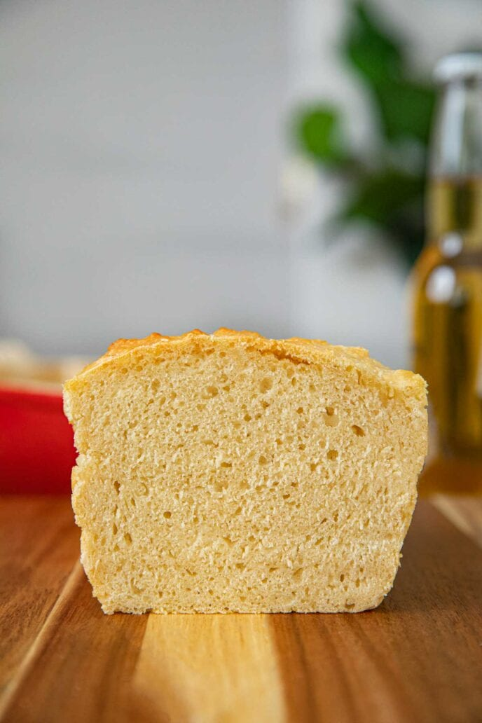 Beer Bread sliced loaf on cutting board