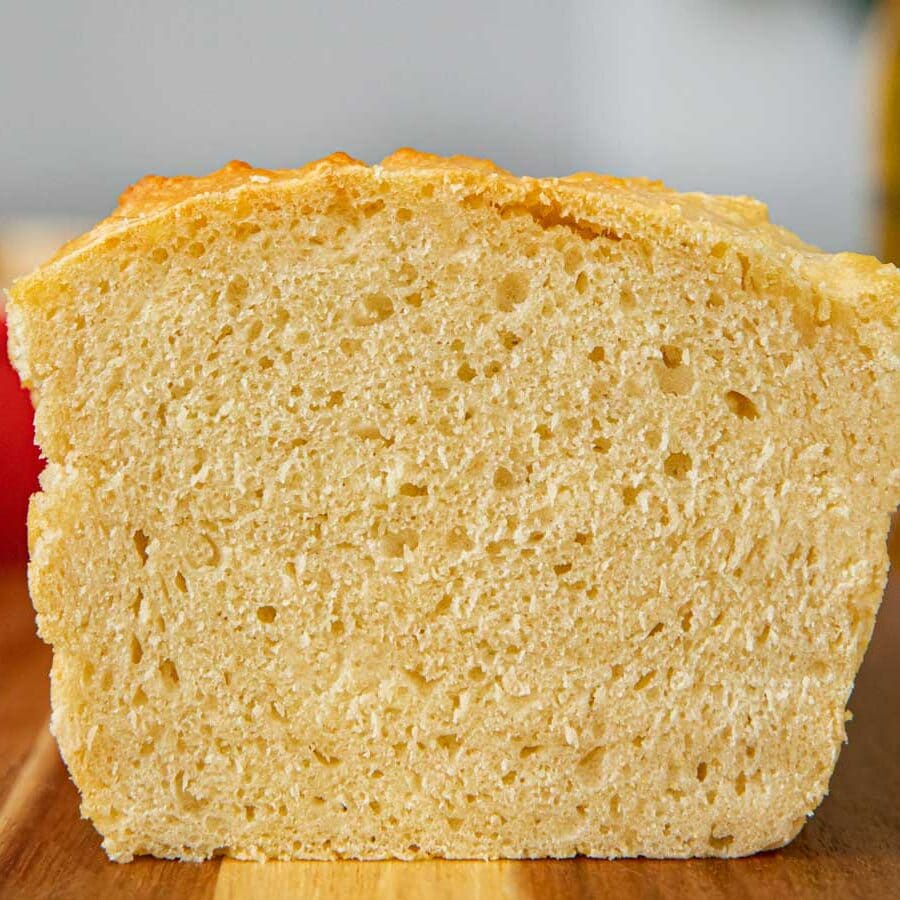 Beer Bread sliced loaf on cutting board