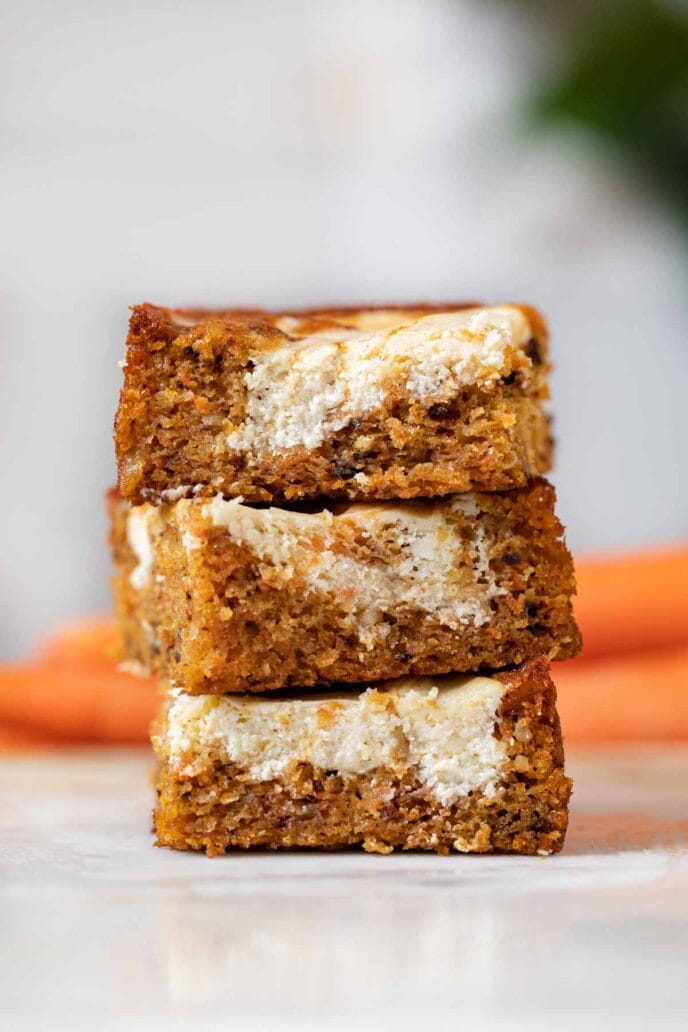 Carrot Cake Cheesecake Bars in stack