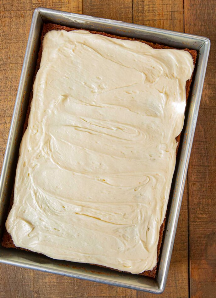 Carrot Sheet Cake with frosting in baking pan