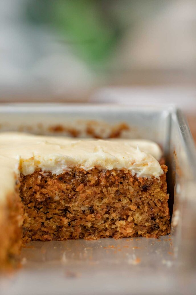 Carrot Sheet Cake in baking pan with slice removed