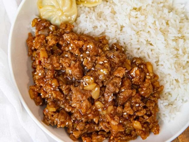 Ground General Tso's Chicken in bowl with rice