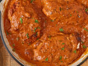 Indian Butter Chicken whole breasts cooked in pan