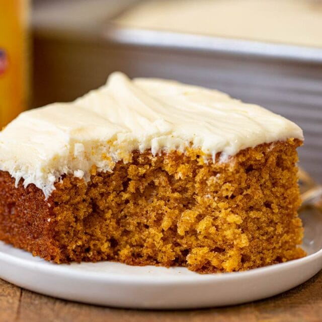 Pumpkin Sheet Cake slice on plate with bite removed