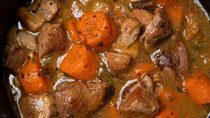 Slow Cooker Pork Chile Verde in black crock pot