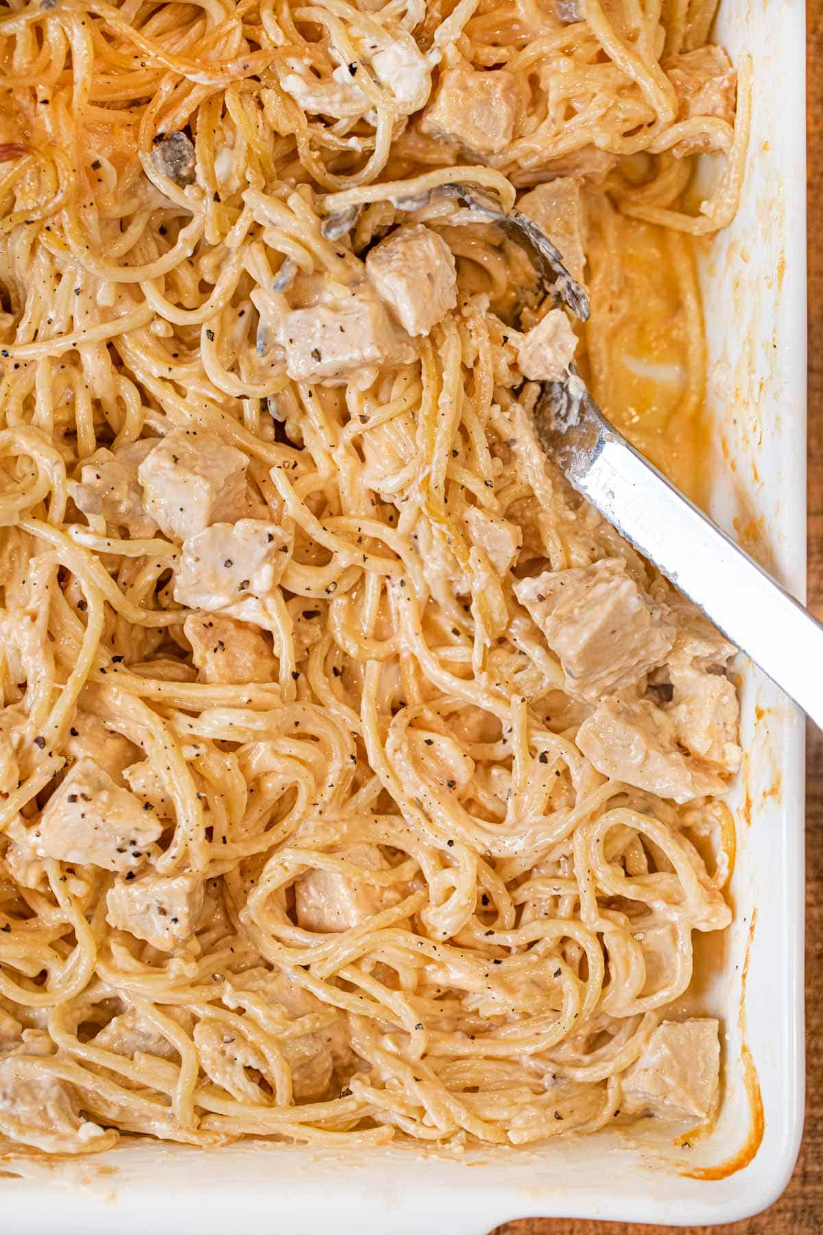 Baked Chicken Spaghetti in baking pan with spoon