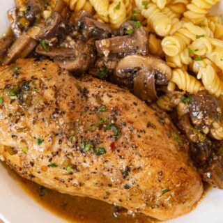 Braised Chicken Breast and Mushrooms serving on plate