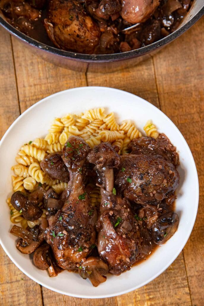Red Wine Braised Legs with Mushrooms serving on plate with rotini pasta