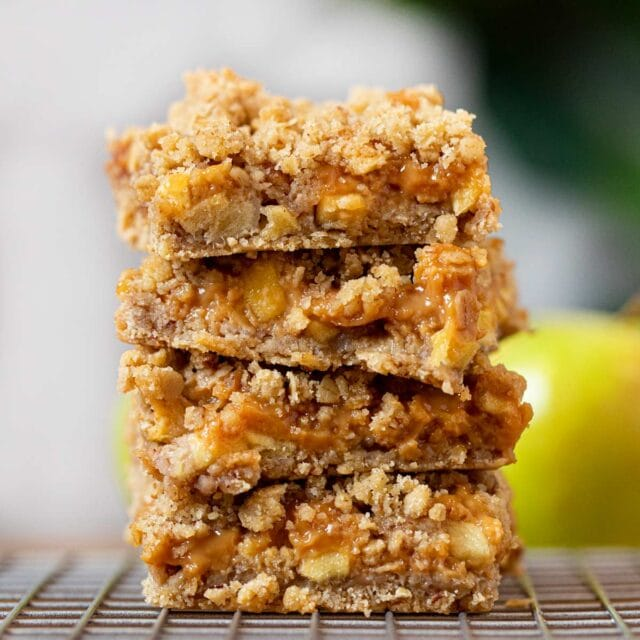 Caramel Apple Bars in a stack on metal cooling rack