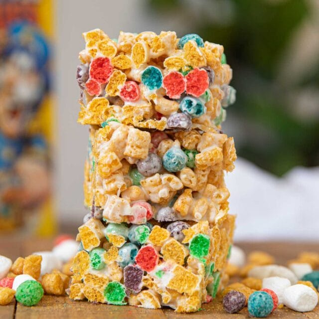 Crunchberry Cereal Marshmallow Bars with cereal box in background