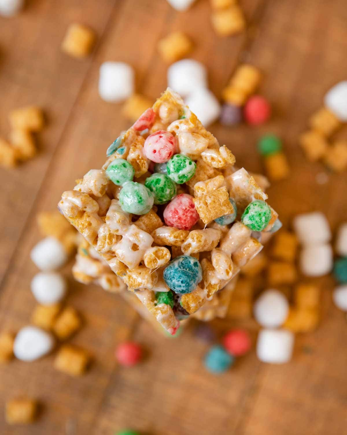 Crunchberry Cereal Marshmallow Bar with cereal and marshmallows next to it