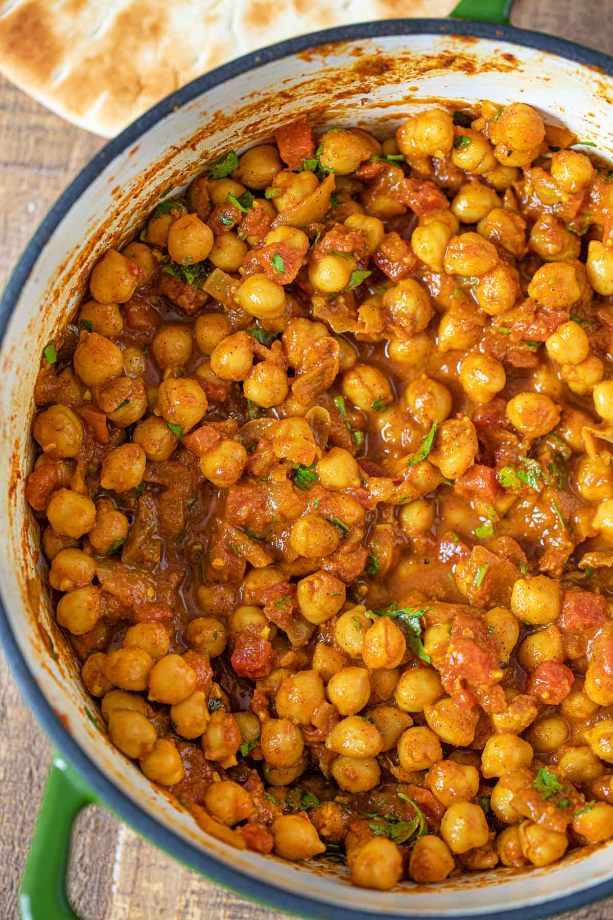Indian Chickpea Chana Masala Curry in green pot