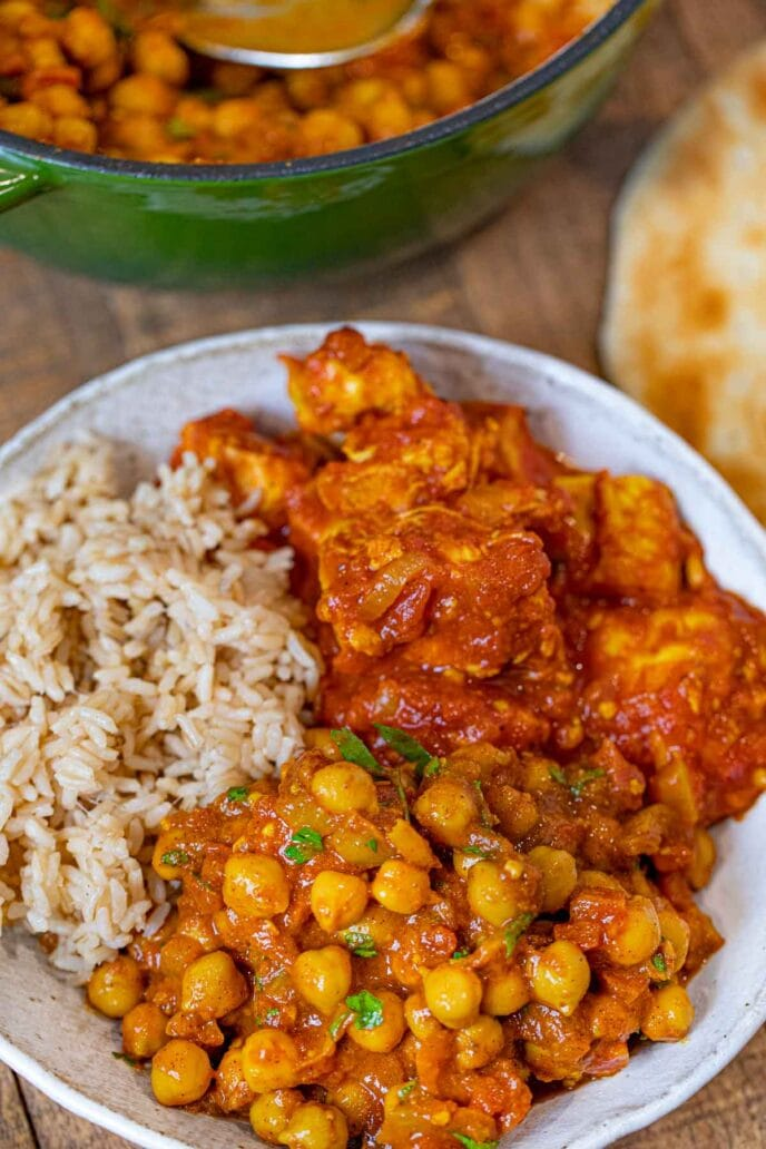Chana Masala in bowl with rice and Indian Tomato Chicken