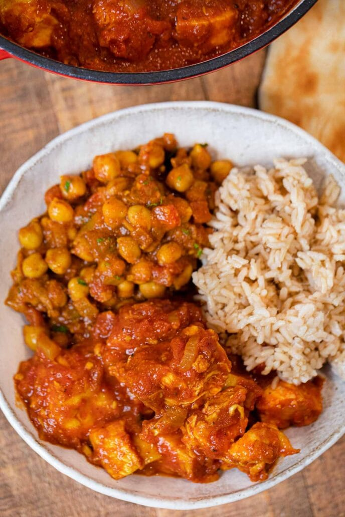 Indian Tomato Chicken in bowl with chickpeas and rice