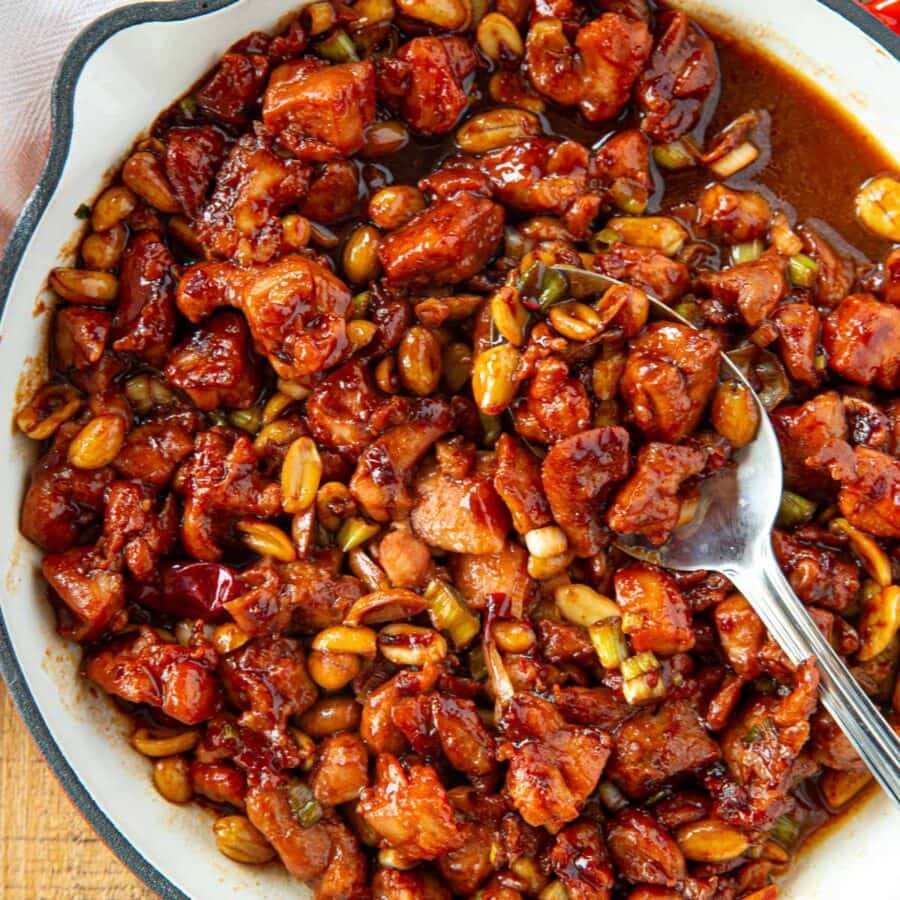 Kung Pao Chicken in pan with spoon
