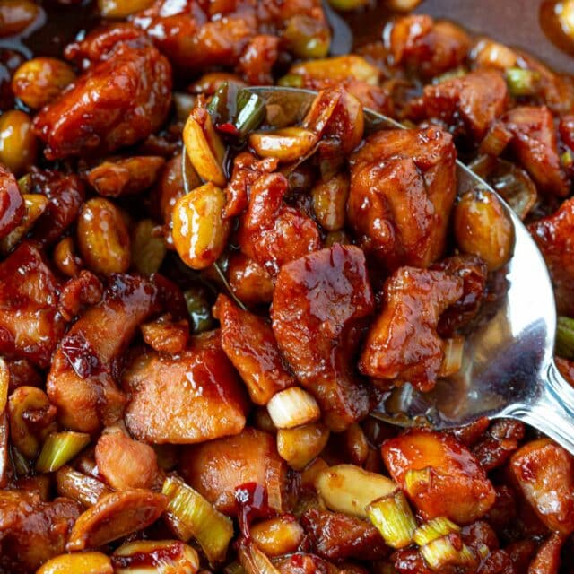 Spoonful of Kung Pao Chicken in pan