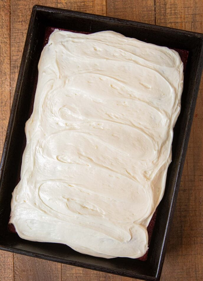 Red Velvet Sheet Cake in baking pan with frosting