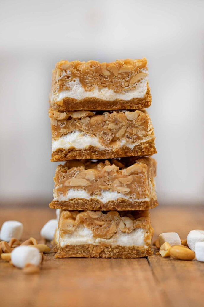 Salted Peanut Chew in stack on brown board