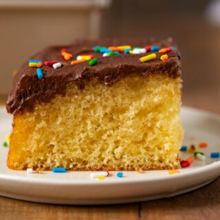 Yellow Sheet Cake with Chocolate Frosting slice on plate