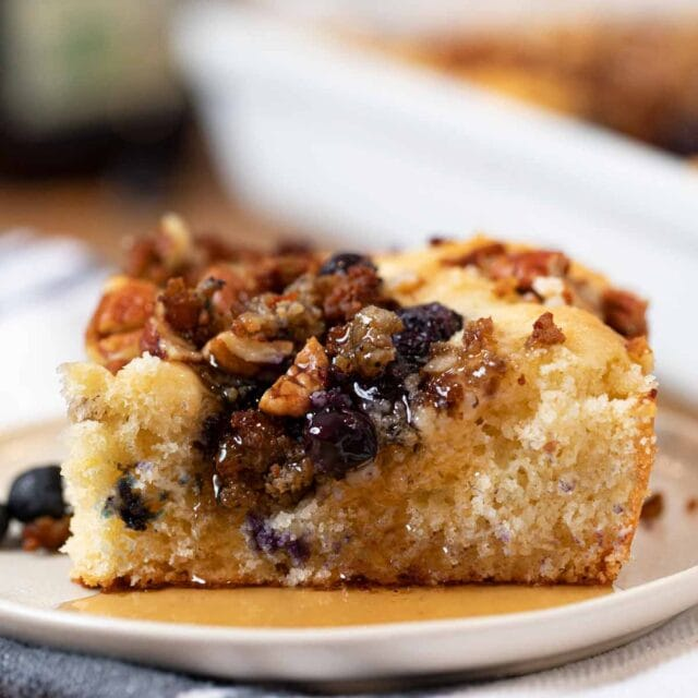 Blueberry Breakfast Casserole with Maple Syrup on plate