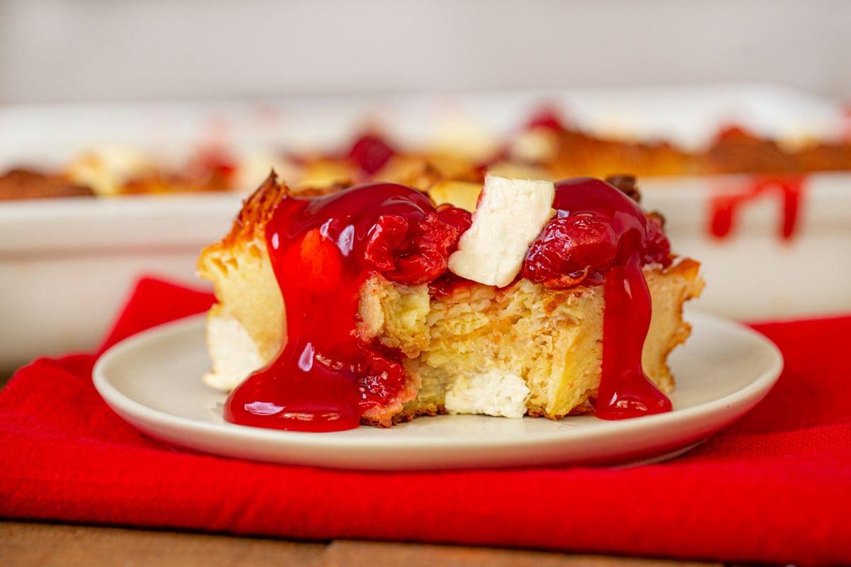 Cherry Danish Breakfast Bake on white plate with red napkin