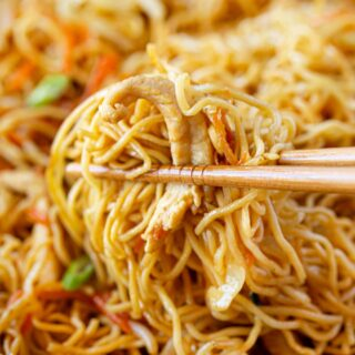 Chicken Chow Mein bite of noodles and chicken in chopsticks